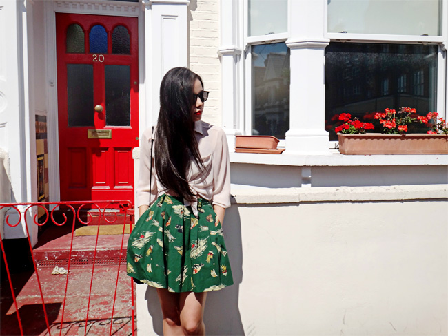 Pleated skirt and sheer blouse London outfit