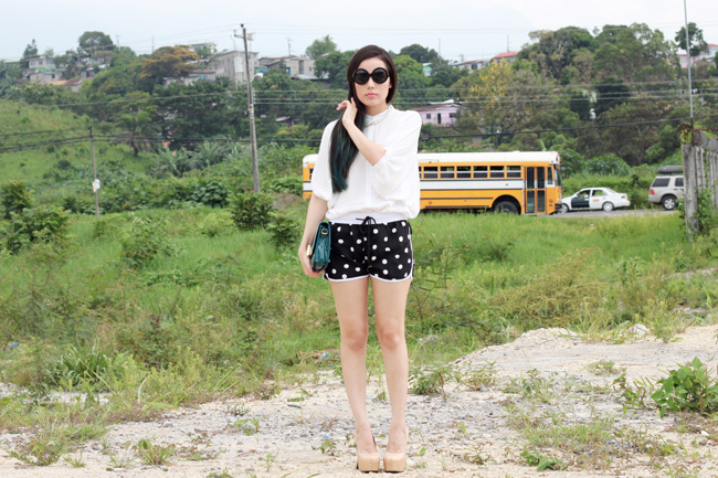 White button-up and polkadot shorts